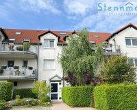 Hübsche 2-Zimmer-Mietwohnung im Hochparterre mit Balkon u. kleinem Garten