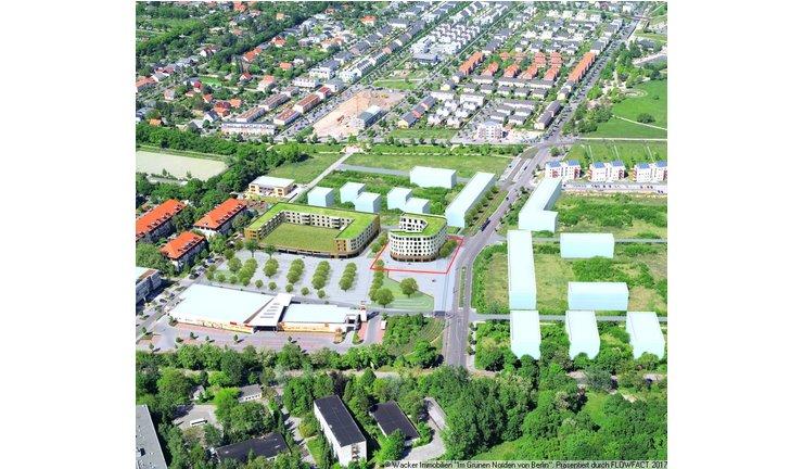 Luftaufnahme mit Projektierung des Wohn- und Geschäftshauses